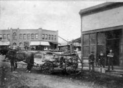 Horse and Wagon delivering water to a business around 1912
