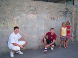 staff and kids by chalk mural