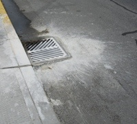 Storm drain with paint spill